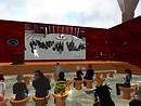 The crowd at Malburns Metahub watches the crowd at Metanomics   main watching  Enterprise 2.0 RL - Chimera Cosmos