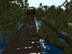 Swaying rope bridge above the bayou of Myst Haven